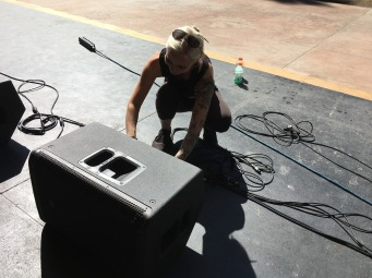 Me setting up monitors at Levitt Pavilion. Photo credit: Andrew Perez